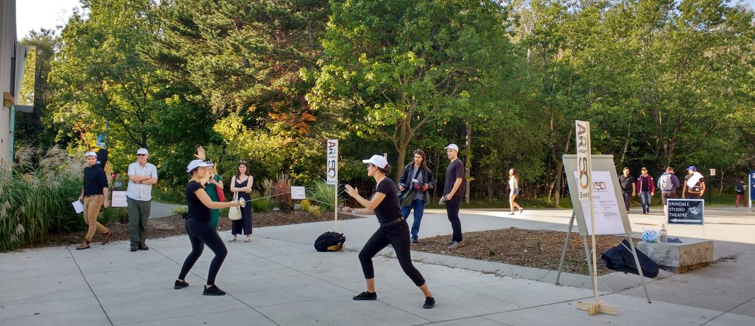 Students fencing in an outdoor area on the UTM campus