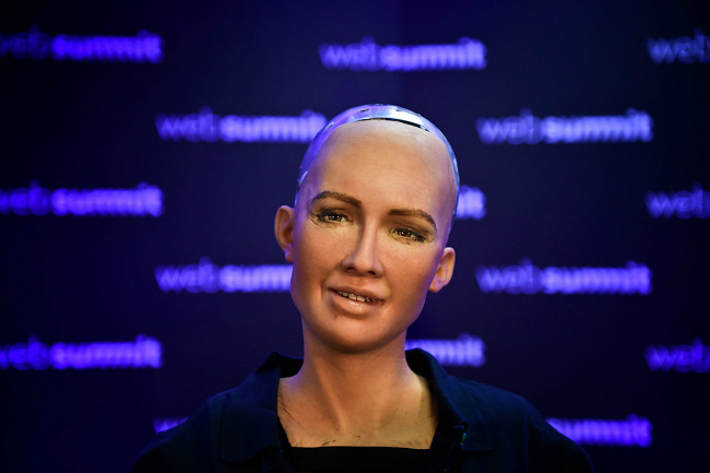 "Head and shoulders of female robot ""Sophia"""