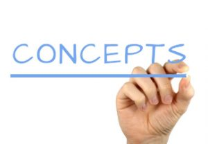 "A hand writing the word ""concepts""."