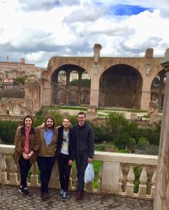Four graduate students in front of the Roman Forum