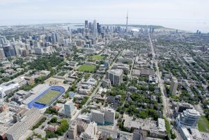 View of Toronto skyline and aerial view of St. George campus.