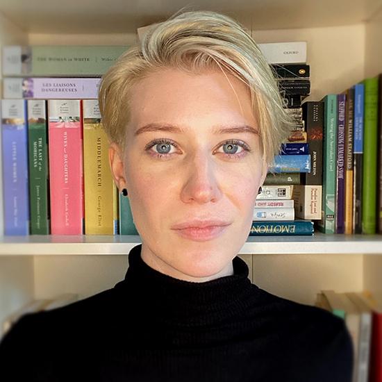 Alexandra Gustafson in front of bookshelf