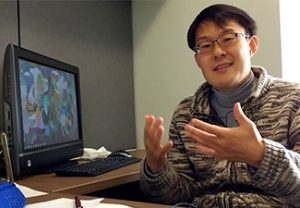 Chunghyoung Lee explaining in front of a computer screen
