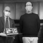 Black-and-white image of Daniel Munro's PhD defense, featuring members of his dissertation committee