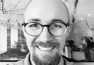 Black-and-white headshot of J Dmitri Gallow