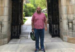 Manuel Vasquez Villvicencio standing in an archway