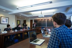 Students in a graduate seminar pay attentiont to a lecture by Mohan Matthen.