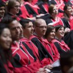 PhD students from a variety of graduate programs listen attentively during their Convocation ceremony.