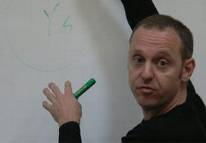 Ted Sider teaching at a white board