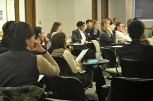audience listens to a presentation at the undergrad conference