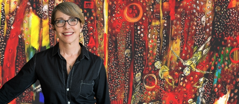 Jessica Wilson in front of a red modern artwork