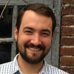 Headshot of Brendan de Kenessey smiling