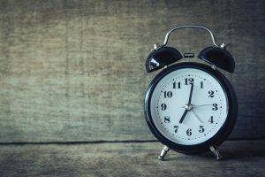 Vintage alarm clock; round face.