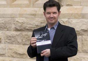 Garrett Cullity holding a book