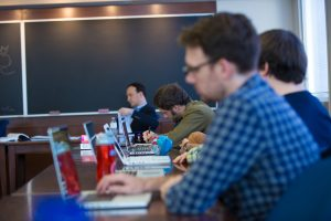 Graduate students take notes in a seminar by Professor Martin Pickavé.