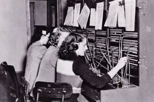 1950s telephone operators sitting at a switchboard