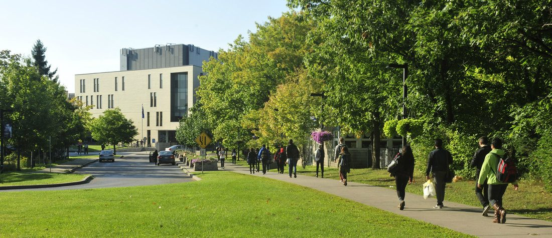 Students walking on a path on UTSC campus.