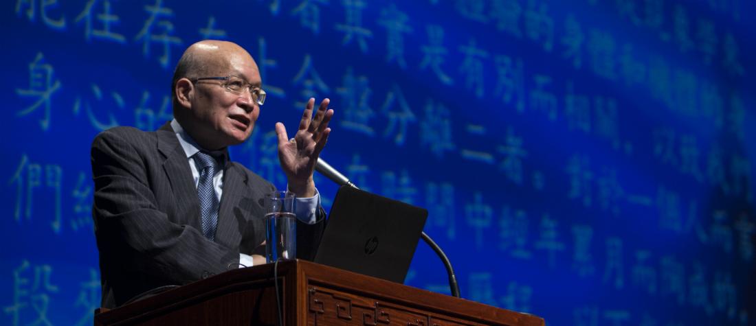 Vincent Shen lectures at podium